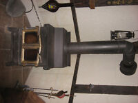 wood stove with piping and chimney