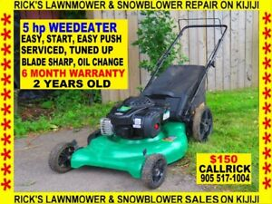 A 5 HP 21'' WEEDEATER BAG AND MULCH MOWER. EASY PUSHEASY START