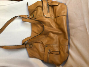 Tan G.H. Bass & Co. leather purse.  $30.00