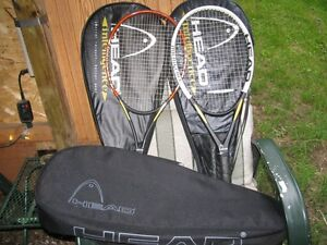 Head tennis racquets with complete carrying cases.