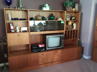 WALL UNIT WITH LOTS OF SHELVES/CUPBOARDS & BLACK TINTED GLASS.