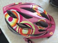 Girl youth size Trek bike helmet.