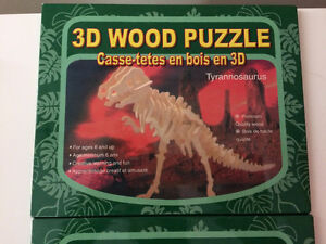 two 3D dinosaur puzzles