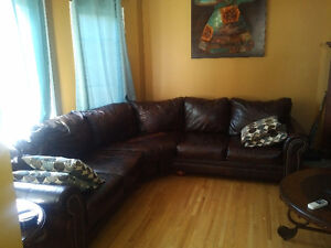 Brown leather curved sofa