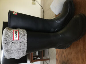 Tall black Hunter boots with winter socks