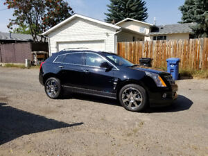 2012 Cadillac SRX premium with 1 year warranty