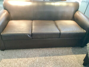 Dark brown sofa.