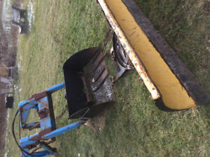 Tractor loader, bucket and plow