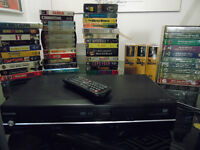 Toshiba DVD/VCR combo, tapes shown and 50+ DVDs