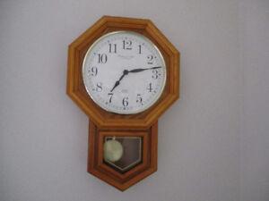 horloge murale à balancier