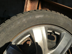 LIKE NEW-  4 BLIZZAK- LM- 25 SNOW TIRES WITH RIMS