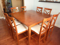 Bar height , Dining room table and 8 chairs