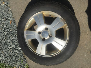 For sale -4 tires and rims (Ford) winter 205 R60 16