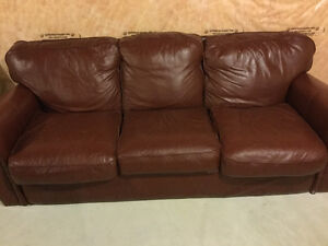 Maroon coloured sofa in good condition
