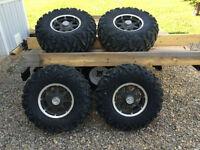 Polaris Aluminum rims and Maxxis tires