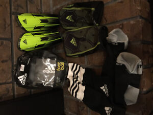 Soccer shin pads and knee high socks, size smallest