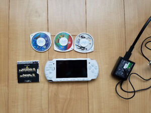 PSP, 3 games, 1 movie, charger (no battery)