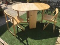 Folding table & 4 chairs.