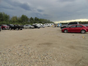 1.4 ACRE INDUSTRIAL LOT FOR RENT FOX CREEK.  ON SITE SECURITY