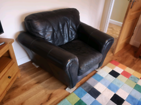 Black leather 2 and 1 seater sofa great condition £150 ono