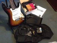 Electric guitar and amplifier bundle