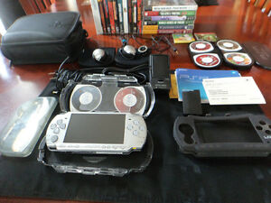 Sony PSP with lots of games,movies and accessories