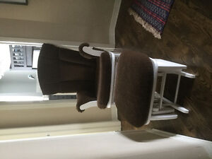 Rocking chair with sliding foot stool