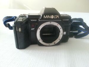 Minolta camera, flash and lenses.