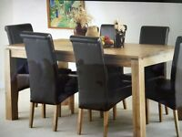 Oak dining table and 6 brown leather high back chairs