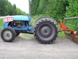 8N tractor c/w blade, chains, plow, disc, culitvator and bucket