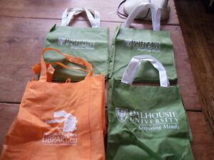 4 reusable grocery or book bags