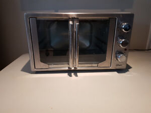 OSTER CONVECTION  COUNTER TOP OVEN