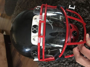 Xenith football helmet, handwarmer and padded compression shorts