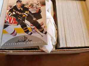 16 full sets of hockey cards excellent condition.