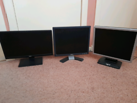 Three desktop computer monitors.