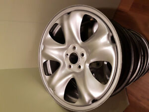 Four 17 inch metal wheels