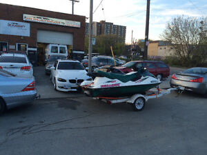 Two seadoos with double trailer