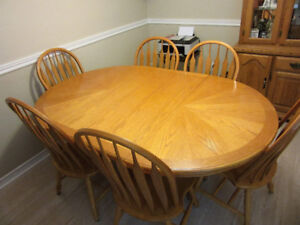 Solid  Pine Pedistool table with leaf and 6 wooden chairs .