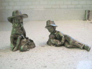 Selling a pair of collectible Holly Hobbie Fine Pewter Figurines