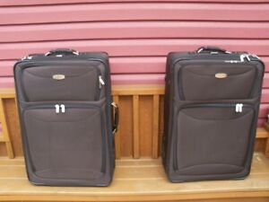 """Matching Pair of 29"""" Upright Suitcases with Pull up handles!"""