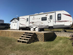 RV Lot with Trailer at Tranquility Bay, Lac Sante
