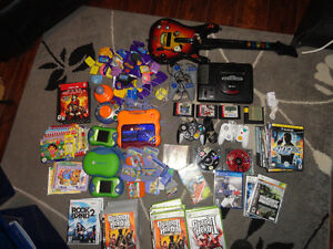 Variety of 140 Video Games Plus 3 Consoles with Accessories