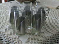 8 glass mugs with silver holder