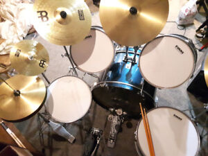 10 piece drum set. 3 years old. new tops $450. 250-492-2293