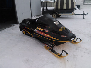 Looking to trade two sleds and trailer