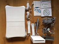 Nintendo wii fit bundle with all original parts and 3 games