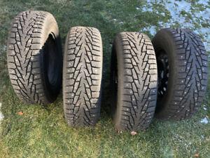 Four 235/70/R16 SUV Studded Snow Tires on rims & balanced
