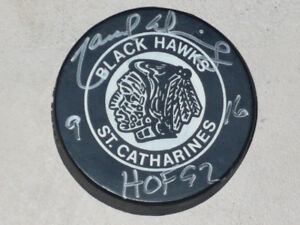 Vintage St. Catharines Black Hawks Puck signed by Marcel Dionne