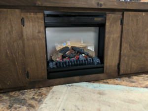 Stunning fire place cabinet just built and stained