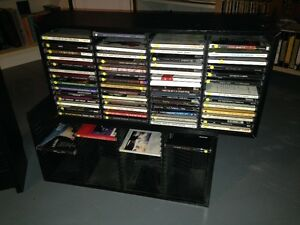 3 different DVD/CD storage racks